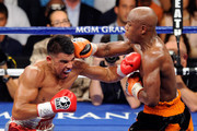 (R-L) Floyd Mayweather Jr. and Victor Ortiz exchange blows during their WBC welterweight title fight at the MGM Grand Garden Arena on September 17, 2011 in Las Vegas, Nevada.