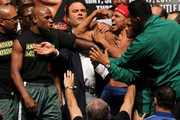 (L-R) Boxer Floyd Mayweather Jr. and Victor Ortiz are held back as they yell at each other after the weigh-in for their WBC welterweight title fight at the MGM Grand Garden Arena on September 16, 2011 in Las Vegas, Nevada. Mayweather and Ortiz will meet in a 12-round bout on September 17, 2011 in Las Vegas, Nevada.