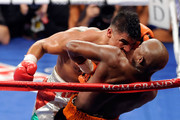 Victor Ortiz reaches his head out as Floyd Mayweather Jr. is against the rope in the fourth round during their WBC welterweight title fight at the MGM Grand Garden Arena on September 17, 2011 in Las Vegas, Nevada. Referee Joe Cortez called Ortiz for an illegal headbutt.