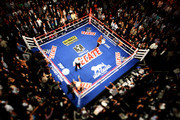 THIS IMAGE WAS TAKEN WITH A TILT-SHIFT LENS) Floyd Mayweather Jr. knocks out Victor Ortiz in the fourth round during their WBC welterweight title fight at the MGM Grand Garden Arena on September 17, 2011 in Las Vegas, Nevada.