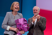 Harriet Harman is presented a bouquet of flowers by Labour Leader Jeremy Corbyn during her tribute on the first day of the Labour Party Autumn Conference on September 27, 2015 in Brighton, England. The former acting labour leader recently stepped down after 28 years on the front bench.