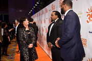 Bank of America Senior Vice President Connie Verducci, former NFL players Willie Colon, and Chris Canty attend the Food Bank for New York City's Can Do Awards Dinner at Cipriani Wall Street on April 17, 2018 in New York City.
