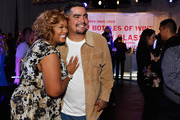 Sunny Anderson and Aarón Sánchez attend Food Networks 20th birthday celebration at Pier 92 on October 17, 2013 in New York City.