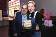 Chef Christina Tosi poses with Lee Schrager(R) during the Food Network & Cooking Channel New York City Wine & Food Festival Presented By Capital One - All About Cake Presented By PureWow Hosted By Christina Tosi of Milk Bar at Union West Events on October 13, 2018 in New York City.