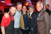 Michael Symon and Geoffrey Zakarian pose with guests during Titans of BBQ presented by National Beef and Pat LaFrieda Meats hosted by Dario Cecchini, Pat LaFrieda and Michael Symon at Pier 97 on October 12, 2019 in New York City.