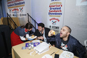 (L-R) Pizza Love founder Kathy Wakile, TV Personality Adam Richman and Goldbelly CEO Joe Ariel attend America's Greatest Sandwich Showdown presented by Goldbelly hosted by Adam Richman and Joe Ariel during the New York City Wine and Food Festival at Highline Stages on October 13, 2019 in New York City.