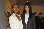 Author Janet Mock (L) and model Chanel Iman attend Forevermark Diamonds Females In Focus Photo Exhibition Event on December 6, 2018 in New York City.