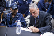 Former Daily Show Host Jon Stewart signs a name placard for Retired New York Police Department detective and 9/11 responder Luis Alvarez following a House Judiciary Committee hearing on reauthorization of the September 11th Victim Compensation Fund on Capitol Hill on June 11, 2019 in Washington, DC.  The fund provides financial assistance to responders, victims and their families who require medical care related to health issues they suffered in the aftermath of 9/11 terrorist attacks.