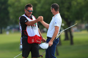 Justin Rose of England celebrates with caddie Mark Fulcher on the 18th green after winning the Fort Worth Invitational at Colonial Country Club on May 27, 2018 in Fort Worth, Texas.
