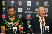 Cameron Smith of Australia and Australia coach Tim Sheens speak to media after losing the Four Nations Rugby League match between the Australian Kangaroos and New Zealand Kiwis at Suncorp Stadium on October 25, 2014 in Brisbane, Australia.