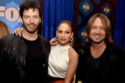 (L-R) American Idol judges musician Harry Connick, Jr., singer Jennifer Lopez and musician Keith Urban of American Idol pose at the Fox Winter TCA All-Star Party at the Langham Huntington Hotel on January 17, 2015 in Pasadena, California.