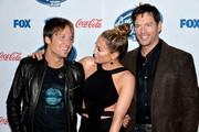 """(L-R) """"American Idol"""" judges musician Keith Urban, actress/singer Jennifer Lopez and musician Harry Connick Jr. arrive at Fox's """"American Idol Xlll"""" Finalists Party at Fig and Olive on February 20, 2014 in West Hollywood, California."""