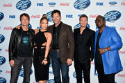"""(L-R) Judges Keith Urban, Jennifer Lopez, Harry Connick, Jr. host Ryan Seacrest and Randy Jackson attend FOX's """"American Idol XIII"""" finalists party at Fig & Olive Melrose Place on February 20, 2014 in West Hollywood, California."""