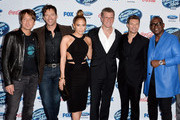 """(L-R) """"American Idol"""" judges musicians Keith Urban, Harry Connick Jr., singer/actress Jennifer Lopez, Kevin Reilly, Chairman of Entertainment, Fox Broadcasting Company, host Ryan Seacrest and musician Randy Jackson arrive at Fox's """"American Idol Xlll"""" Finalists Party at Fig and Olive on February 20, 2014 in West Hollywood, California."""