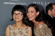 "Actors Charlyne Yi (L) and Odette Annable arrive at Fox's ""House"" series finale wrap party at Cicada on April 20, 2012 in Los Angeles, California."