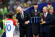 FIFA President Gianni Infantino greets Luka Modric of Croatia as President of Russia Valdimir Putin and French President Emmanuel Macron looks on during the 2018 FIFA World Cup Final between France and Croatia at Luzhniki Stadium on July 15, 2018 in Moscow, Russia.