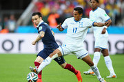 Andy Najar of Honduras  and Mathieu Valbuena of France battle for the ball during the 2014 FIFA World Cup Brazil Group E match between France and Honduras at Estadio Beira-Rio on June 15, 2014 in Porto Alegre, Brazil.