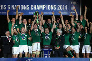 Brian O'Driscoll (C) and captain Paul O'Connell (C) of Ireland celebrate with their team-mates as they lift the trophy after winning the six nations championship with a 22-20 victory over France during the RBS Six Nations match between France and Ireland at Stade de France on March 15, 2014 in Paris, France.
