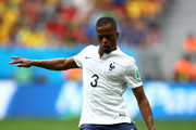 Patrice Evra of France controls the ball during the 2014 FIFA World Cup Brazil Round of 16 match between France and Nigeria at Estadio Nacional on June 30, 2014 in Brasilia, Brazil.