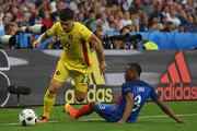 Cristian Sapunaru of Romania and Patrice Evra of France compete for the ball during the UEFA Euro 2016 Group A match between France and Romania at Stade de France on June 10, 2016 in Paris, France.