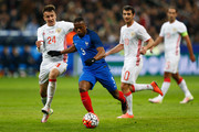 Patrice Evra of France battles for the ball with Aleksandr Golovin of Russia during the International Friendly match between France and Russia held at Stade de France on March 29, 2016 in Paris, France.