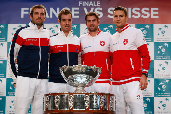 The current doubles line up Marco Chiudinelli of Switzerland, Michael Lammer of Switzerland with Richard Gasquet of France and Julien Benneteau of France pose for a photo at the draw during previews for the Davis Cup Tennis Final between France and Switzerland at the Place du Theatre on November 20, 2014 in Lille, France.