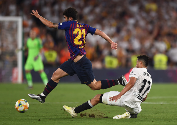 Barcelona vs. Valencia - Spanish Copa del Rey Final [player,sports,soccer player,tournament,sports equipment,football player,football,team sport,ball game,soccer,francis coquelin,barcelona v valencia,spanish,match,tackles,valencia,seville,spain,fc barcelona,copa del rey final]