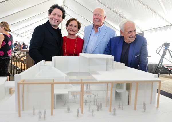 Unveiling Of The Judith And Thomas L. Beckmen Yola Center At Inglewood [l-r,photo,social group,community,event,team,table,design,architecture,furniture,interior design,collaboration,the judith and thomas l. beckmen yola center,gustavo dudamel,frank gehry,judith,inglewood,thomas l. beckmen yola center,los angeles philharmonic,design unveiling]