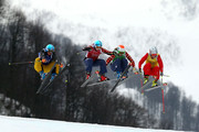 (L-R) Anna Woerner of Germany, Kelsey Serwa of Canada, Georgia Simmerling of Canada, Fanny Smith of Switzerland compete in the Freestyle Skiing Womens' Ski Cross Quarter Finals on day 14 of the 2014 Winter Olympics at Rosa Khutor Extreme Park on February 21, 2014 in Sochi, Russia.