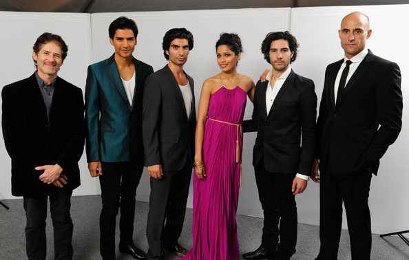 Freida Pinto (L-R) Composer James Horner, actors Jan Uddin, Akin Gazi, Freida Pinto, Tahar Rahim and Mark Strong pose for a portrait in the portrait studio at Katara Cultural Village during the 2011 Doha Tribeca Film Festival on October 25, 2011 in Doha, Qatar.