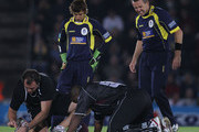 Kieron Pollard of Somerset goes to ground after being hit by a delivery from Dominic Cork (R) of Hampshire during the Friends Provident T20 Final between Hampshire Royals and Somerset at The Rose Bowl on August 14, 2010 in Southampton, England.