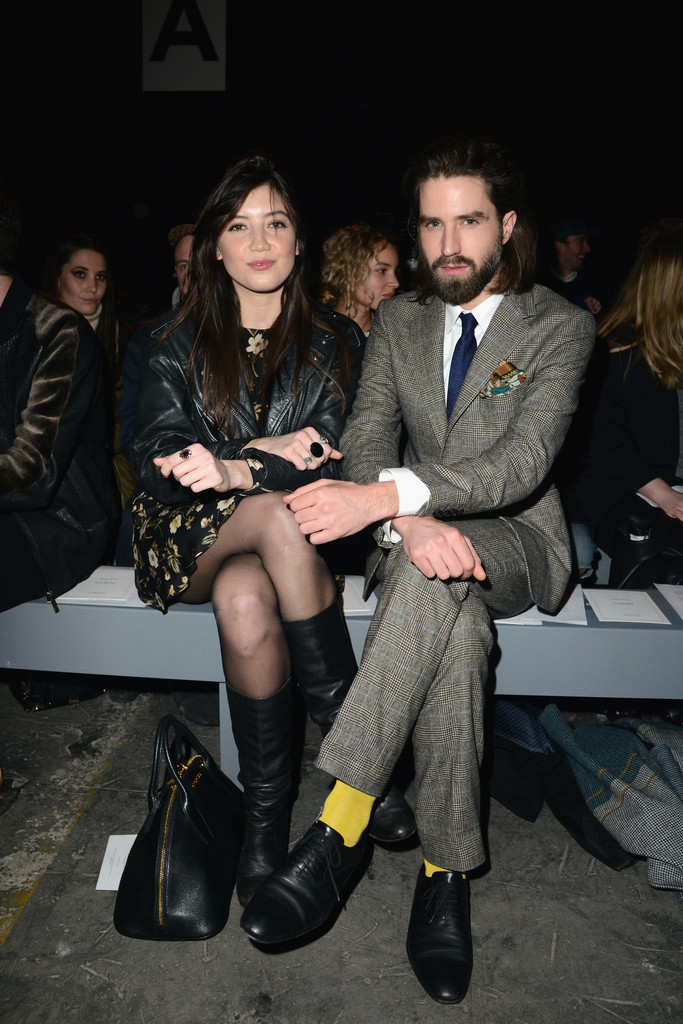 (L-R) Daisy Lowe and Jack Guinness attend the Casely-Hayford show during The London Collections: Men Autumn/Winter 2014 on January 7, 2014 in London, England.