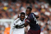 Andre-Frank Zambo Anguissa of Fulham battles with Danny Welbeck of Arsenal during the Premier League match between Fulham FC and Arsenal FC at Craven Cottage on October 7, 2018 in London, United Kingdom.