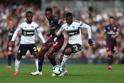 Danny Welbeck of Arsenal and Andre-Frank Zambo Anguissa of Fulham during the Premier League match between Fulham FC and Arsenal FC at Craven Cottage on October 7, 2018 in London, United Kingdom.