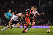 Brett Pitman of Bournemouth is chased by Scott Parker (R) and Shaun Hutchinson of Fulham (L) during the Sky Bet Championship match between Fulham and AFC Bournemouth at Craven Cottage on March 6, 2015 in London, England.
