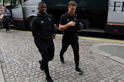 Floyd Ayite (L) and Scott Parker (R) of Fulham arrive at the ground ahead of the Sky Bet Championship match between Fulham and Newcastle United at Craven Cottage on August 5, 2016 in London, England.