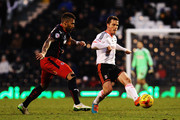 Scott Parker (R) of Fulham holds off the challenge of Daniel Williams (L) of Reading during the Sky Bet Championship match between Fulham and Reading at Craven Cottage on January 17, 2015 in London, England.