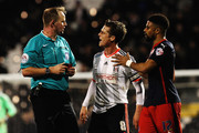 Scott Parker (C) of Fulham talks to match referee Mark Brown (L) during the Sky Bet Championship match between Fulham and Reading at Craven Cottage on January 17, 2015 in London, England.