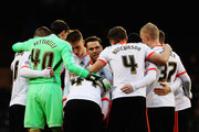 Fulham captain Scott Parker talks to his team mates before the FA Cup Third Round match between Fulham and Wolverhampton Wanderers at Craven Cottage on January 3, 2015 in London, England.