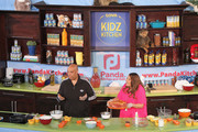 Rev Run (L) and Justine Simmons participate at Fun and Fit as a Family sponsored by Carnival featuring Goya Kidz Kitchen during the 2015 Food Network & Cooking Channel South Beach Wine & Food Festival presented by FOOD & WINE at Jungle Island on February 21, 2015 in Miami, Florida.