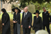 """Prince Charles, Prince of Wales (R) follows the Duke and Duchess of Devonshire,  Lady Sophia Cavendish (2ndR) and Lady Emma Cavendish (L) during the funeral of Deborah, Dowager Duchess of Devonshire makes it's way to St Peters Church, Edensor, past Chatsworth House on October 2, 2014 in Chatsworth, England. Deborah Cavendish, Dowager Duchess Of Devonshire, the last surviving Mitford sister, died aged 94 on September 24, 2014. Deborah was known as the """"housewife duchess"""", and her noted business acumen made Chatsworth House one of the most successful and profitable stately homes in England."""
