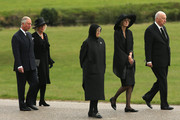"""Prince Charles, Prince of Wales and Camilla, Duchess of Cornwall follow the Duke of Devonshire (R), Lady Sophia Cavendish and Lady Emma Cavendish (C) as the funeral of Deborah, Dowager Duchess of Devonshire makes it's way to St Peters Church, Edensor, past Chatsworth House on October 2, 2014 in Chatsworth, England. Deborah Cavendish, Dowager Duchess Of Devonshire, the last surviving Mitford sister, died aged 94 on September 24, 2014. Deborah was known as the """"housewife duchess"""", and her noted business acumen made Chatsworth House one of the most successful and profitable stately homes in England."""