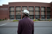 James Wright waits for the Friendly Temple Missionary Baptist Church to open for the funeral service of Michael Brown on August 25, 2014 in St. Louis, Missouri. Michael Brown was shot and killed by a police officer in the nearby town of Ferguson, Missouri on August 9. His death caused several days of violent protests along with rioting and looting in Ferguson