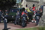 The Duke of Edinburgh's coffin, covered with his personal standard, is carried by a Land Rover Defender hearse is followed by Prince Charles, Prince of Wales during the funeral of Britain's Prince Philip, Duke of Edinburgh at Windsor Castle on April 17, 2021 in Windsor, England. Prince Philip of Greece and Denmark was born 10 June 1921, in Greece. He served in the British Royal Navy and fought in WWII. He married the then Princess Elizabeth on 20 November 1947 and was created Duke of Edinburgh, Earl of Merioneth, and Baron Greenwich by King VI. He served as Prince Consort to Queen Elizabeth II until his death on April 9 2021, months short of his 100th birthday. His funeral takes place today at Windsor Castle with only 30 guests invited due to Coronavirus pandemic restrictions.