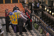 The Duke of Edinburgh's coffin, covered with His Royal Highness's Personal Standard is displayed in St George's Chapel as Queen Elizabeth II (R) watches during the funeral of Prince Philip, Duke of Edinburgh at Windsor Castle on April 17, 2021 in Windsor, United Kingdom. Prince Philip of Greece and Denmark was born 10 June 1921, in Greece. He served in the British Royal Navy and fought in WWII. He married the then Princess Elizabeth on 20 November 1947 and was created Duke of Edinburgh, Earl of Merioneth, and Baron Greenwich by King VI. He served as Prince Consort to Queen Elizabeth II until his death on April 9 2021, months short of his 100th birthday. His funeral takes place today at Windsor Castle with only 30 guests invited due to Coronavirus pandemic restrictions.