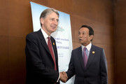 Britain's Chancellor of the Exchequer Philip Hammond (L) shakes hands with Taro Aso, Japan's Deputy Prime Minister  during meeting at the G20 Finance Ministers and Central Bank Governors conference on July 23, 2016 in Chengdu, China. Finance Ministers and Central Bank Governors of the 20 most developed economies met in the southwestern city of Chengdu ahead of a G20 leaders meeting in September hosted by China.