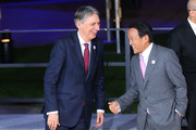 Finance Minister of the United Kingdom Philip Hammond  (L) and Japanese Finance Minister Taro Aso (R) attend the family photo during the G20 finance ministers meeting on March 17, 2017 in Baden-Baden, Germany. The meeting is taking place ahead of the G20 summit scheduled in Hamburg in July.