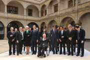 German Finance Minister Wolfgang Schaeuble (C) arrives for the group photo of finance ministers, central bank governors, and global financial institution heads during a meeting of finance ministers of the G7 group of nations on May 28, 2015 in Dresden, Germany. The G7 finance ministers are meeting ahead of the upcoming G7 summit at Schloss Elmau in June.