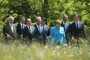 (From L to R) President of the European Commission Jean-Claude Juncker, Italian Prime Minister Matteo Renzi, French President Francois Hollande, President of the European Council Donald Tusk, Japanese Prime Minister Shinzo Abe, German Chancellor Angela Merkel, U.S. President Barack Obama and British Prime Minister David Cameron arrive for the group photo at the summit of G7 nations at Schloss Elmau on June 7, 2015 near Garmisch-Partenkirchen, Germany. In the course of the two-day summit G7 leaders are scheduled to discuss global economic and security issues, as well as pressing global health-related issues, including antibiotics-resistant bacteria and Ebola. Several thousand protesters have announced they will seek to march towards Schloss Elmau and at least 17,000 police are on hand to provide security.