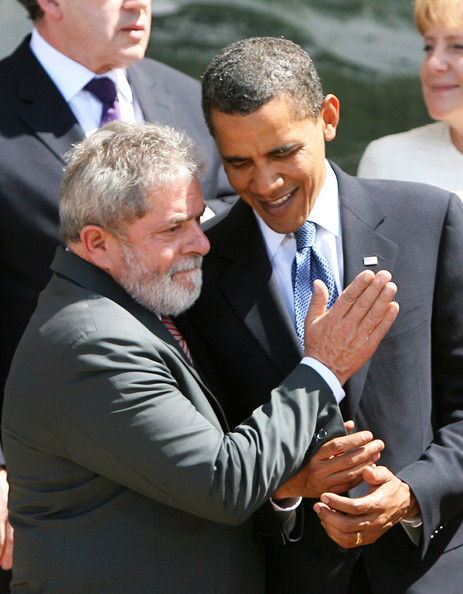 Brazil's President Luiz Inacio Lula da Silva (L) greets U.S. President Barack Obama while waiting for the junior G8 family photo at the G8 summit on July 9, 2009 in L'Aquila, Italy. Eight World leaders attending the G8 summit will reportedly discuss the economic recovery from the recession as well as global warming and international trade.